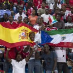 Supporters hold flags from Spain and Ecuatorial Guinea before a friendly soccer match at Malabo Stadium in Malabo, Equatorial Guinea, Saturday, Nov. 16, 2013. (AP Photo/Diario AS, Juan Flor)